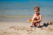 Boy making sand castle on beach