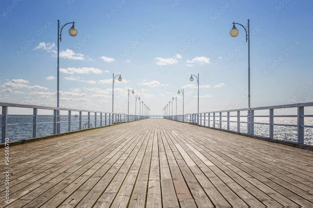Fototapety, obrazy: Old empty wooden pier over the sea shore with copy space