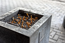 Cigarettes In A Public Ashtray