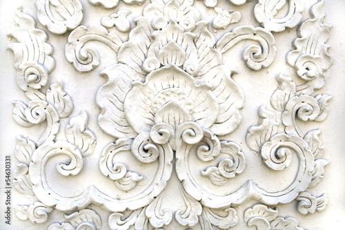 Fotografia  White thai art stucco wall,Thai temple