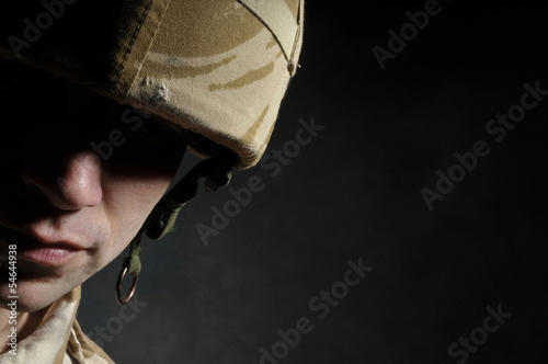 Fotografie, Obraz  Portrait Of Soldier In Deep Shadow Suffering With PTSD