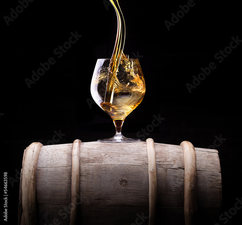 Cognac or brandy on a wooden barrel