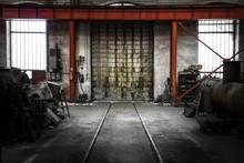 Old Metal Gate In Vehicle Repair Station