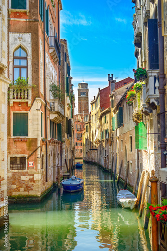 Venice cityscape, water canal, church and buildings. Italy