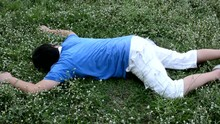 An Asian Guy Is Drop Dead On The Grassy Ground And Twitching