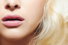 Beautiful Blond Woman. Pink Lips. Face Without Eyes