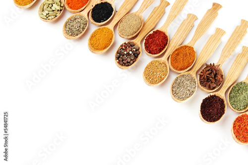 Deurstickers Kruiden 2 Assortment of spices in wooden spoons, isolated on white