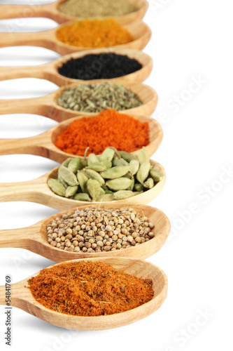 Fotobehang Kruiden 2 Assortment of spices in wooden spoons, isolated on white