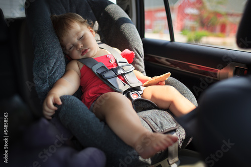 Child sleeping in car seat - Buy this stock photo and explore ...
