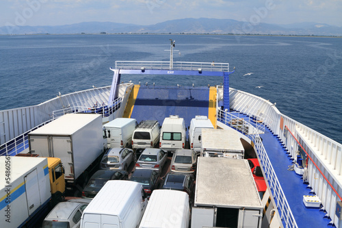 Fototapeta ferry boat loaded with cars and trucks