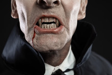 Close-up Of Dracula With Black Cape Showing His Scary Teeth. Vam