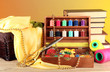 Sewing kit in wooden box with books and cloth table