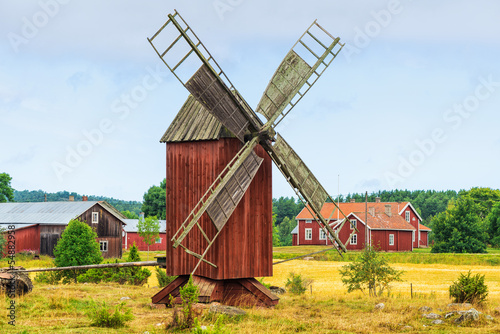 Tuinposter Molens Old windmill in a rural landscape - Åland, Finland