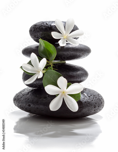 Photo  tiare flowers and tower black stone spa