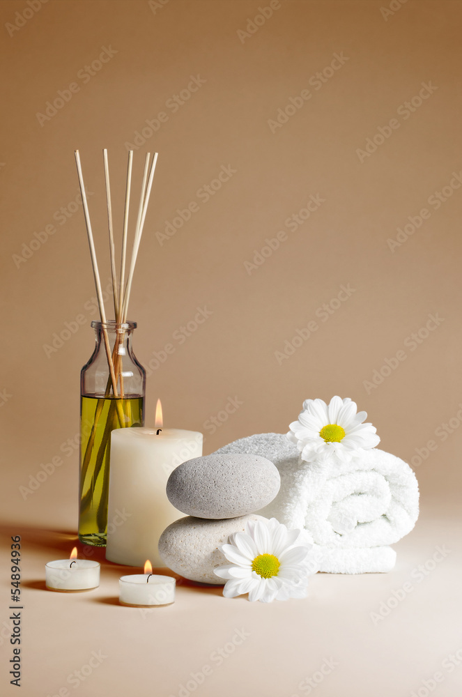 Fototapeta spa decoration with flowers, stones, candles and massage oil