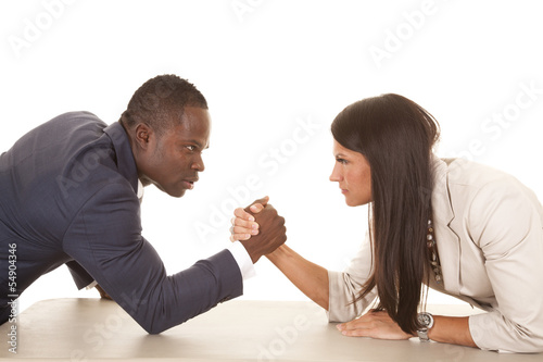 Fotografie, Obraz  business man and woman arm wrestle serious