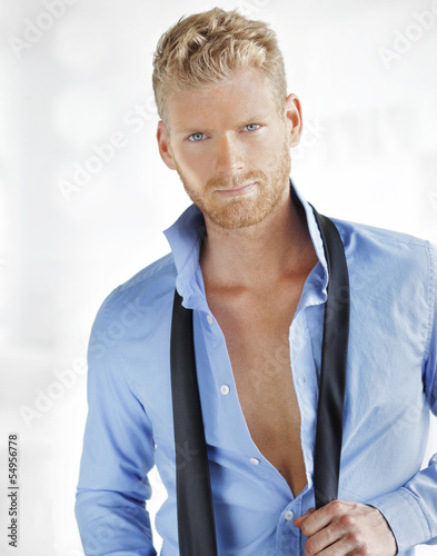 Sexy young business guy afterhours Wallpaper Mural