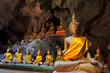 Old Buddha statues in the cave of Thailand