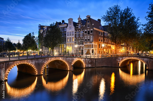 Photo  Night scene at a canal in Amsterdam