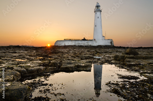 Photo Stands Lighthouse Reflected St Marys Lighthouse at sunset