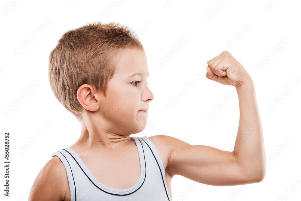 Fototapeta Smiling sport child boy showing hand biceps muscles strength