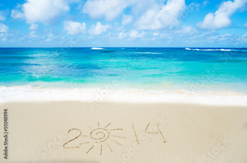 Photo Number 2014 on the sand - holiday concept