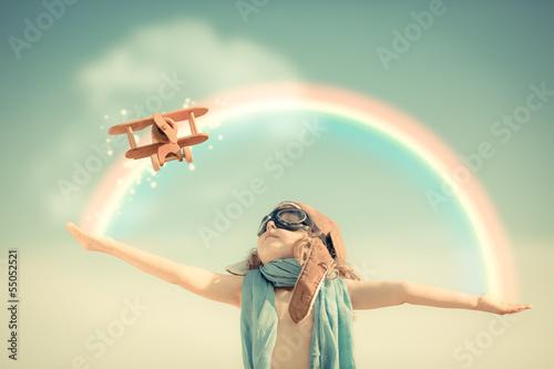 Fototapeta na wymiar Happy kid playing with toy airplane