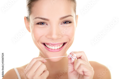 Valokuva  Dental flush - woman flossing teeth smiling