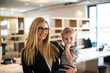Leinwanddruck Bild - Businesswoman with small child in the office
