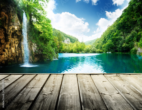 Tuinposter Bleke violet waterfall in deep forest of croatia and wood pier