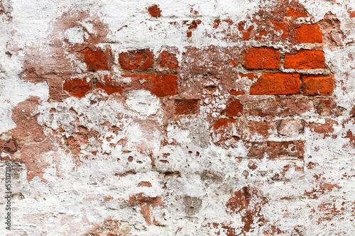 abandoned painted brick wall