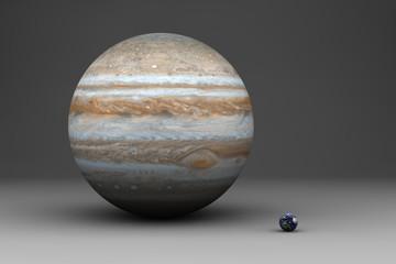 Die Planeten Erde und Jupiter im Größenvergleich