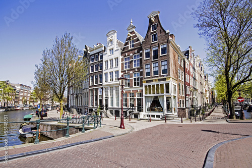 Photo  Medieval houses along the canal in Amsterdam Netherlands