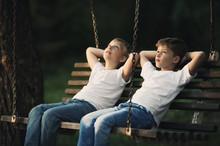 Little Boys Riding On Swing
