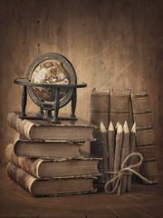 Fototapeta samoprzylepna Stack of books and globe