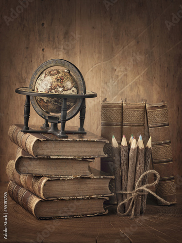 Stack of books and globe