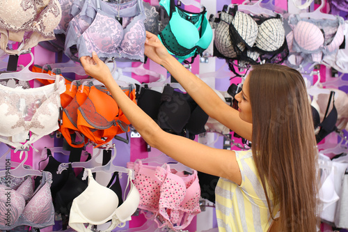 Beautiful young woman in shop with underwear - Buy this stock photo ... 3d448b6f6
