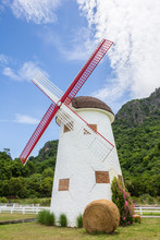 Vintage Windmill With Straw Bales