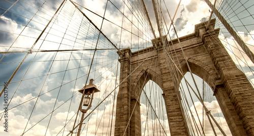 Tuinposter Brooklyn Bridge Brooklyn Bridge, New York City. Upward view with beautiful sky c