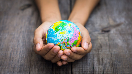 Fototapeta Person holding a globe