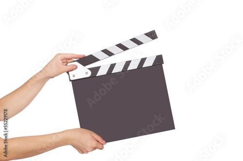 Fotografía human hand holding a movie clapboard