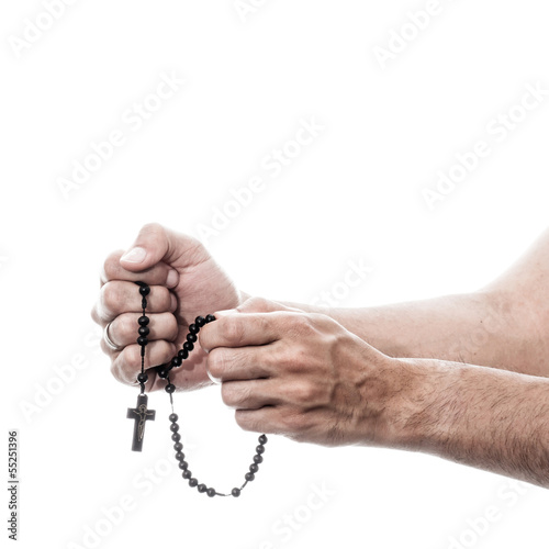 male hands praying with rosary Fototapeta