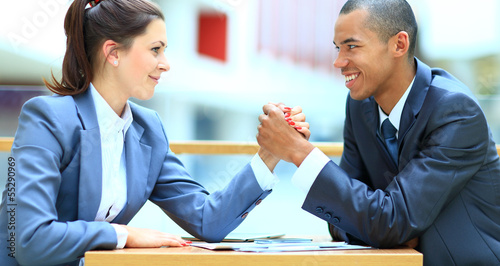 Fotografie, Obraz  Business couple arm wrestling at the office