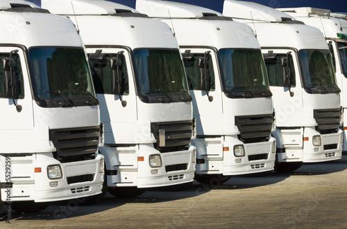 white parked trucks