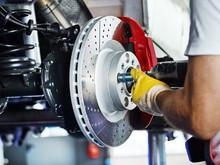 Car Mechanic In A Garage Repai...