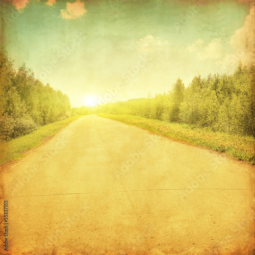 Fotobehang Meloen Rural road through the forestat sunset.Grunge and retro style.