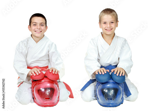 Deurstickers Vechtsport Athletes in kimono sitting in a ritual pose karate with helmets