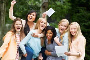Six Teenage Girls Celebrating Successful Exam Results