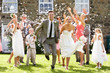 canvas print picture - Guests Throwing Confetti Over Bride And Groom