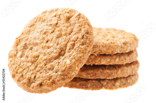 Tela a pile of oats biscuits on a white background